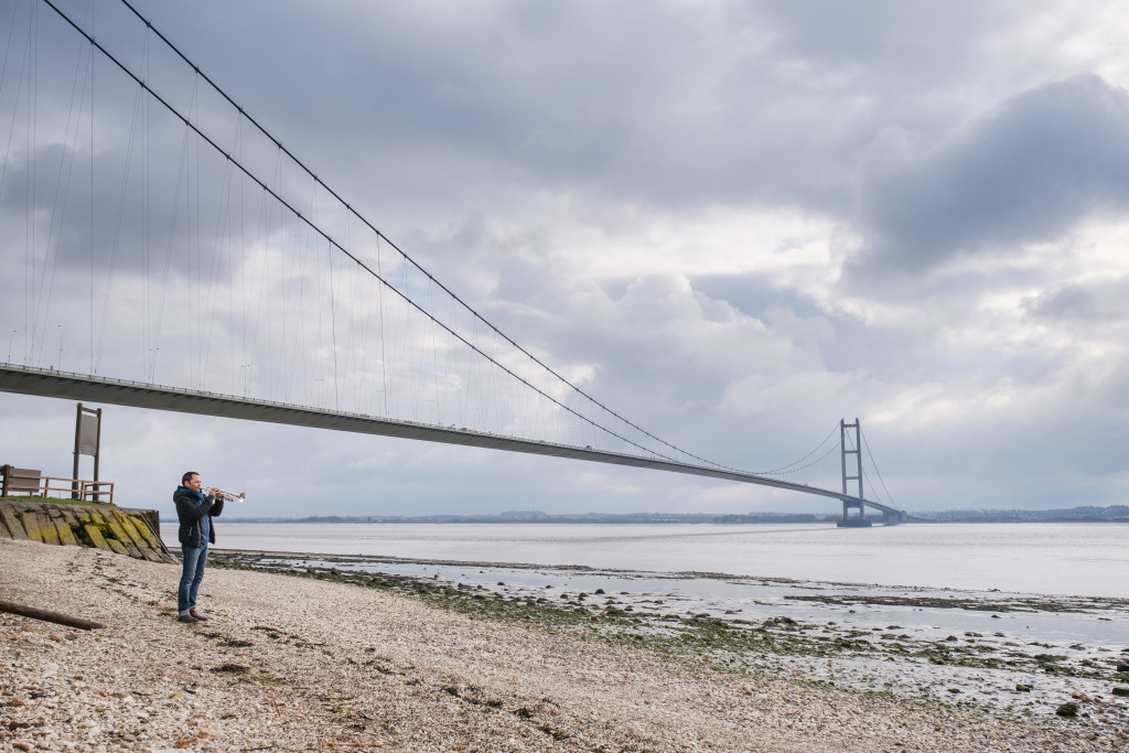 Arve Henriksen tries the trumpet, together with Humber Bridge. Photo - Tom Arber