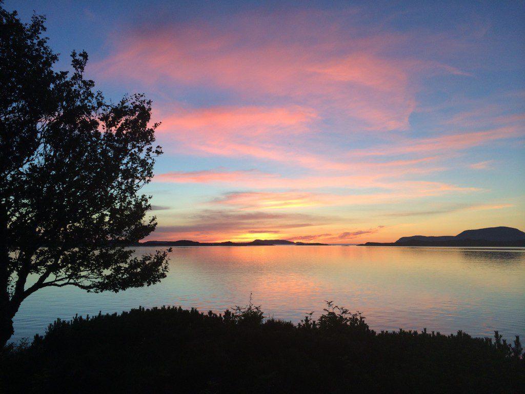 Sunset over a Norwegian fjord landscape